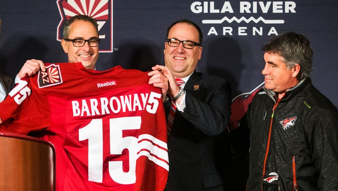 Arizona Coyotes new majority owner Andrew Barroway (left) receives a jersey from co-owner, president and CEO Anthony LeBlanc, and Coach Dave Tippett (right) during a press conference at Gila River Arena on Jan. 2, 2015.