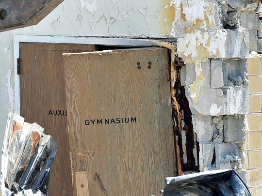 A section of  the former Central Junior High School at the old gym is demolished on Monday, July 17, 2017. Developer Vern McKissick has plans to transform the building at Queen and Third streets into luxury apartments.