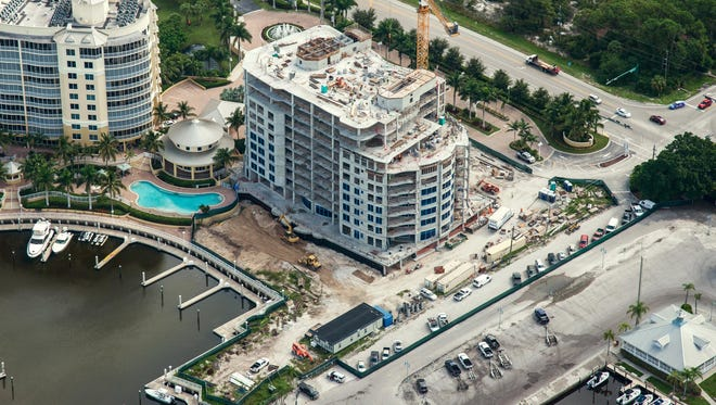 Tower II has been topped off at Aqua at Pelican Isle, a marina-front community on Vanderbilt Drive in North Naples.