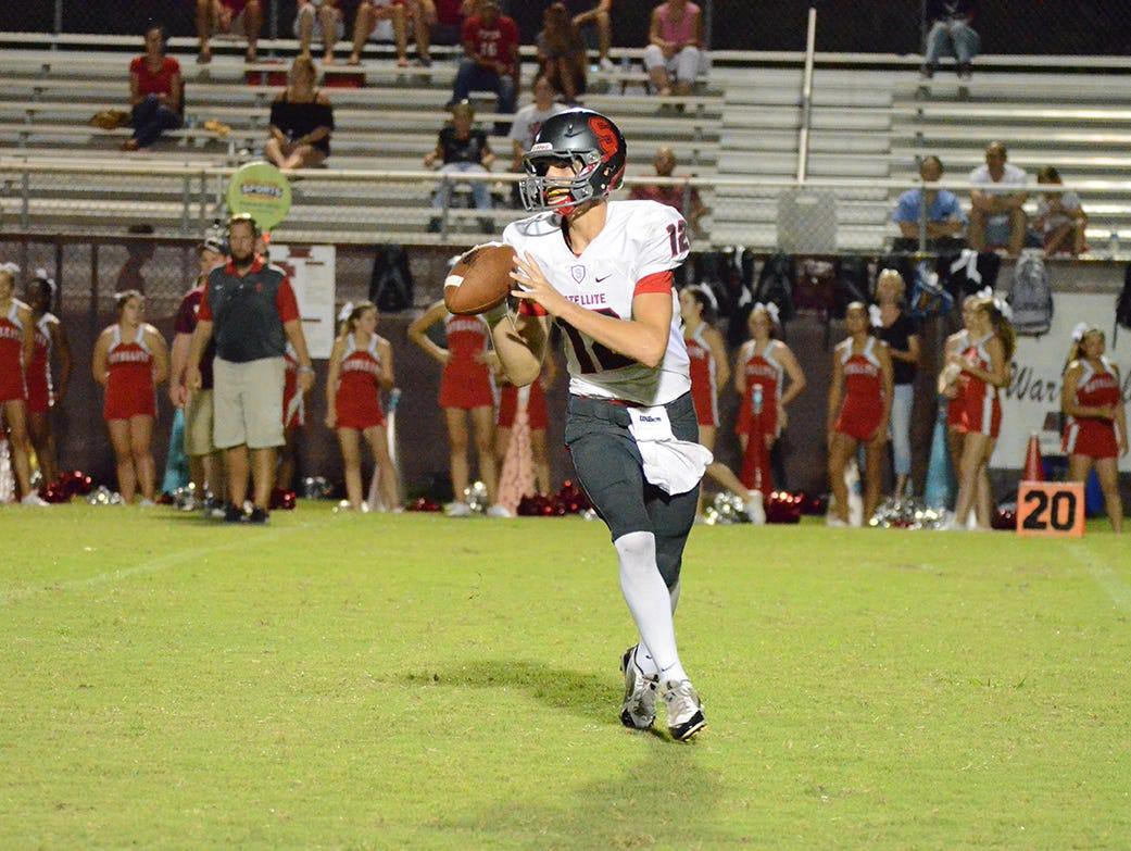 Satellite Beach High School quarterback Noah Mumme rolls out in an away game against Astronaut High School.