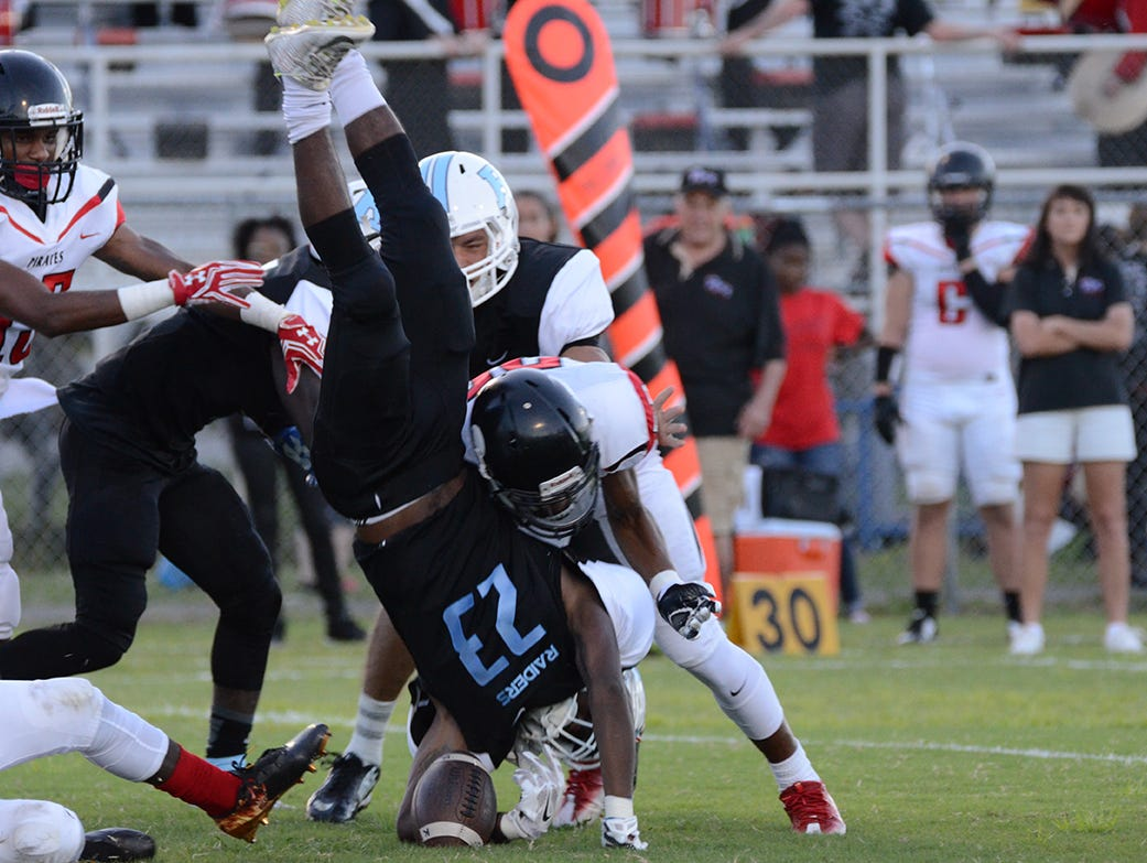 Rockledge Raider Vaurice Griffin Jr is upended in the opening kickoff Friday night in their home game against the Palm Bay Pirates