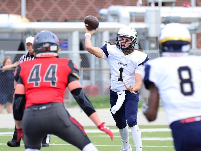 Eau Gallie quarterback Hunter Smith attempts a pass