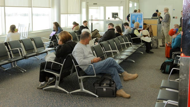 Passengers wait in the departure area of the Greater Binghamton Airport.