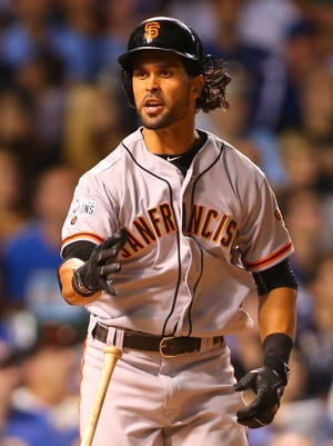 Giants center fielder Angel Pagan reacts after hitting a pop fly at Wrigley Field.