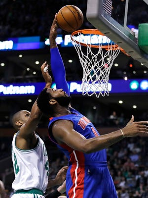Andre Drummond, right, taps in a rebound against Celtics center Al Horford during the second half of the Pistons' 113-109 loss in Boston on Jan. 30, 2017.