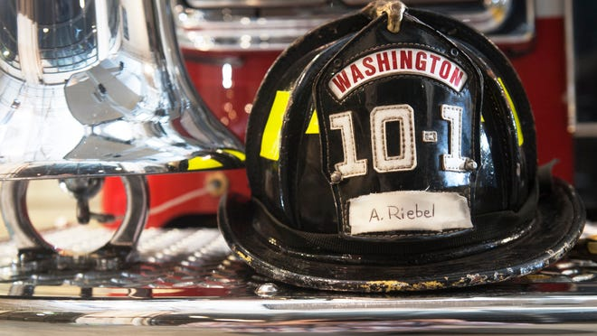The fire helmet of Washington Township firefighter Eric Fitzpatrick bears the name of 7-year Aiden Riebel of Washington Township,  who is fighting acute myeloid leukemia, as the helmet sits on a firetruck in the Grenloch Station 10-1 in Washington Township to show support for Riebel who was sworn in as Washington Townshipâ??s first honorary firefighter a year ago.   11.06.14