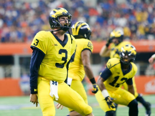 Michigan quarterback Wilton Speight celebrates a touchdown