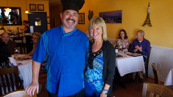 Christian Vivet and his wife Mari  Saturday in their restaurant, Blue Windows Bistro in south Fort Myers. The restaurant will close from June to October during the slow season.