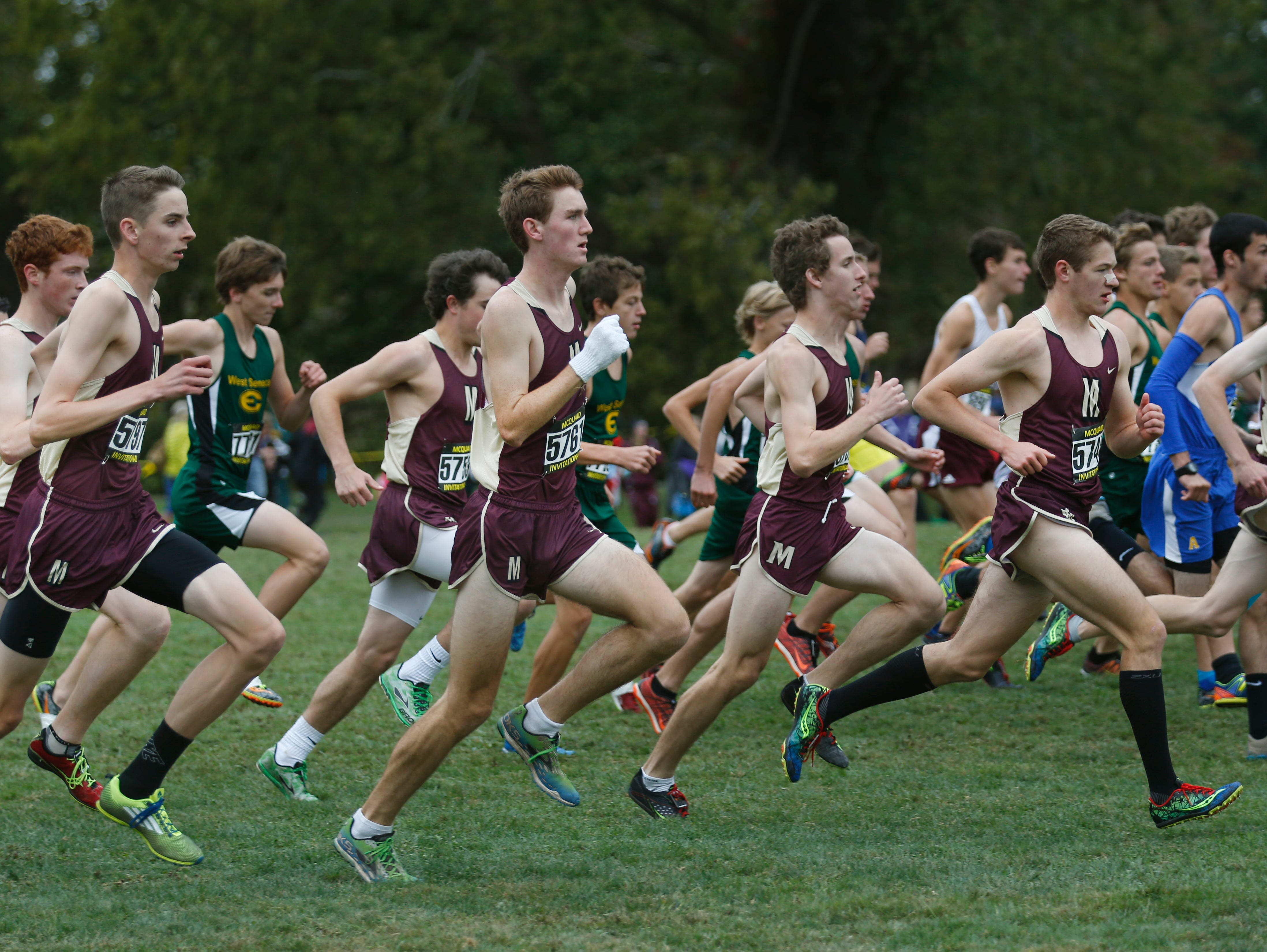 Pittsford Mendon runners start the Boys Varsity Seeded AA race during the McQuaid Invitational cross country meet at Genesee Valley Park.