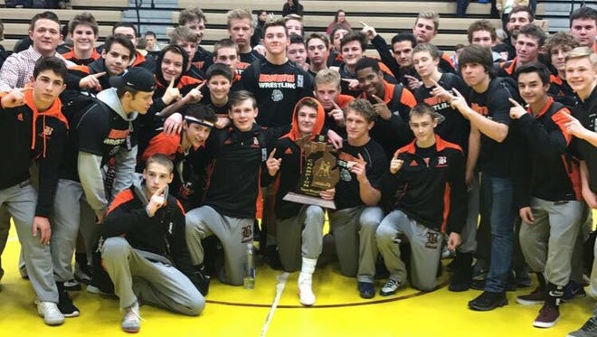 The Brighton wrestling team got its revenge on Grand Ledge and is heading to the Division 1 team quarterfinals.