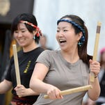 Nagisa Kirby (right) of Monmouth Taiko, a group that plays Japanese percussion instruments, performs during Cherry Blossom Day on Saturday, March 28, 2015, at the Oregon State Capitol in Salem.