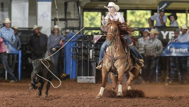 Amanda Coleman of Stephenville is pictured calf roping.
