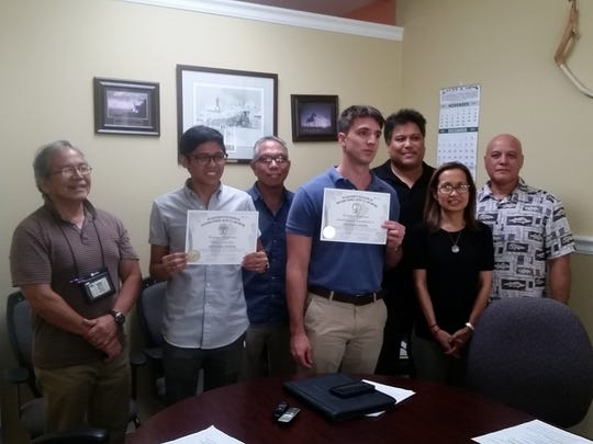 The Guam Board of Registration for Professional Engineers, Architects & Land Surveyors congratulates two New Professional Engineers who successfully passed the Professional Engineer Exam.Pictured are Board members from left: Paul L. Santos, PLS, Member; Elijah Gozum Soto, PE; Hernan Bonsembiante, Jr., PE; Maria Elizabeth V. Cristi, PE, Sec./Tres.; Glen Leon Guerrero, DPW Director; Back Row from left: Philip Villanueva, Public Member and Gabriel A. Jugo, PE, SE, Chairman.