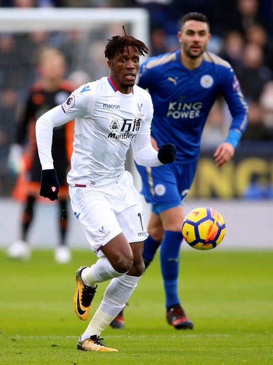 Crystal Palace's Wilfried Zaha controls the ball during the English Premier League soccer match against Leicester City at the King Power Stadium, Leicester, England, Saturday Dec. 16, 2017. (Nigel French/PA via AP)