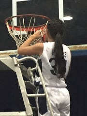 Haley Salas cuts down the net after the St. AnthonyÕs