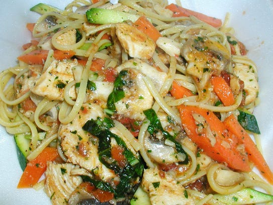 Ready for takeout is a serving of pasta primavera.