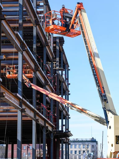 Hydraulic lifts seemingly surround the Multi-Institutional