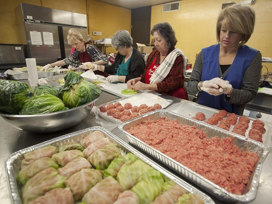 Volunteers, from left, Judy Watts, Phoebe Spencer, Rose Mary Foncree and Paula Erlich prepare stuffed cabbage rolls at the Beth Israel Temple in Jackson. The ladies are preparing for the annual Beth Israel Bazaar.