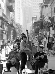 """This photo of New Orleans street musicians, """"NOLA Band,"""" is a Rising Star Award and a Gold ADDY winner for MTSU student Jackee LaFever at the recent Nashville Student ADDY Awards, presented by the American Advertising Federation Nashville. LaFever, a senior graphic design major from Christiana, Tenn., also received a Silver ADDY in the direct marketing competition for her """"Music Unites Perpetual Calendar."""""""