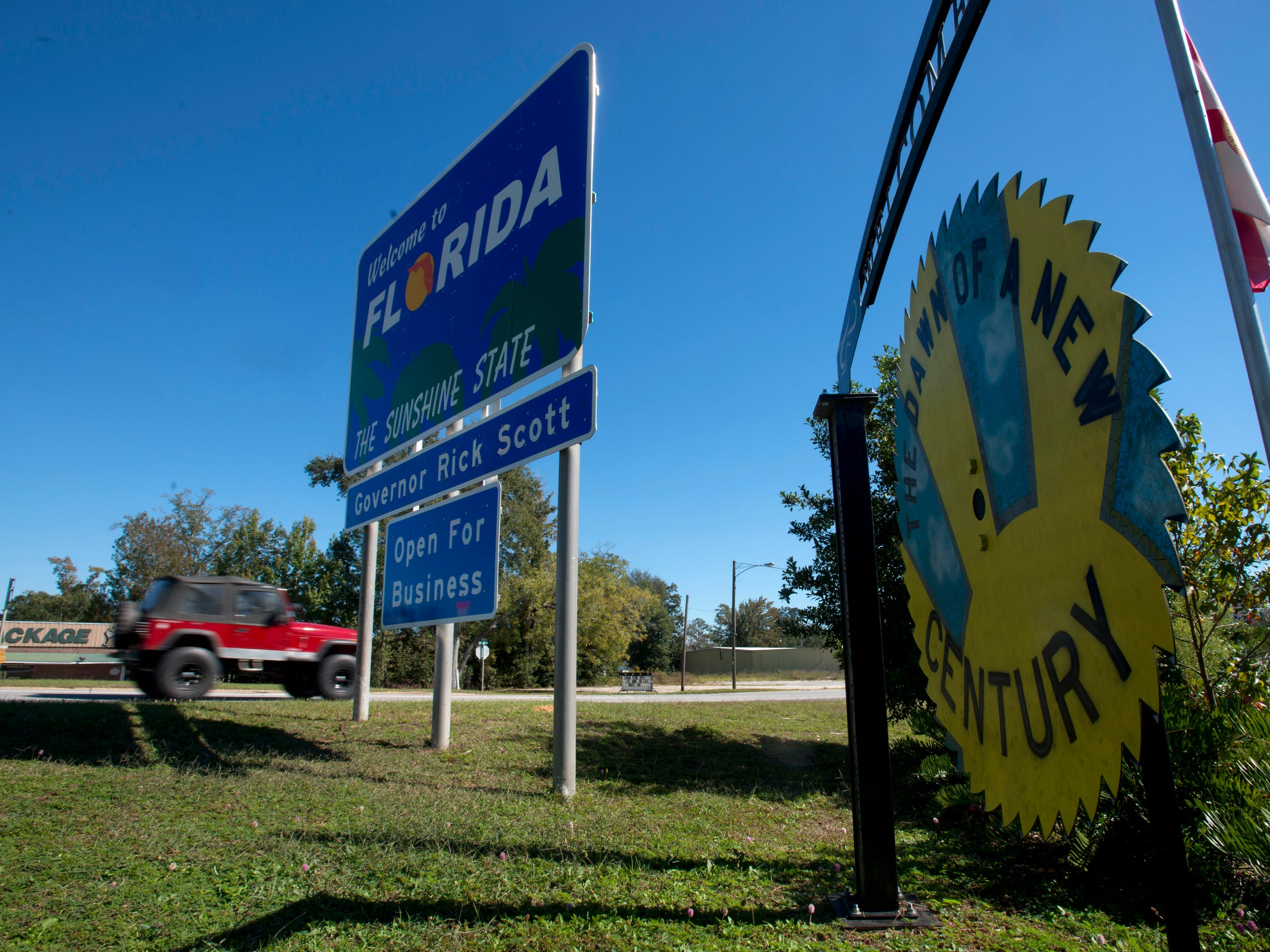 """A sign on Hwy 29 welcomes motorists to """"The Dawn of a New Century."""""""