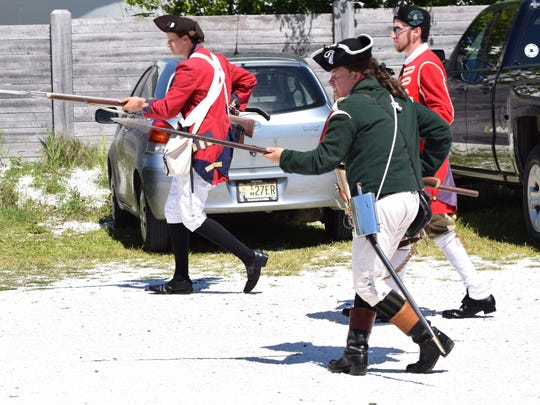 Royal American Reformers Michael Esposito, Kevin Titus and Jacob Zonderman reenact the Revolutionary War skirmish at Dallas Landing during Heritage Day on Saturday at the Bayshore Center at Bivalve. Photo/Jodi Streahle