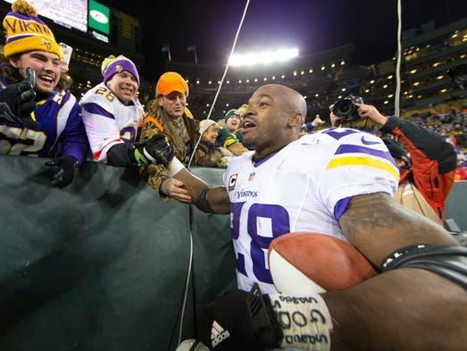 Adrian Peterson celebrates his fans after the Vikings