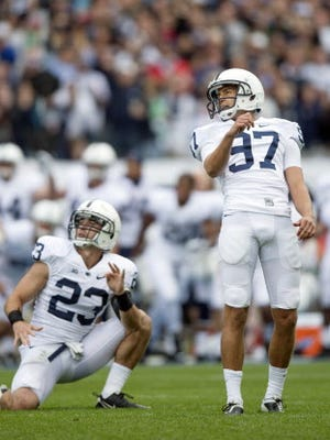 Sam Ficken watches as his 37 yard field goal goes through the uprights to secure Penn State's victory.
