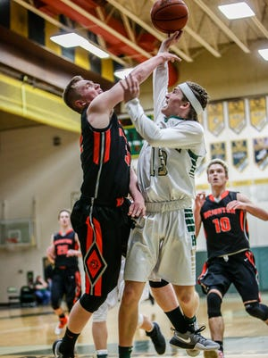 Howell's Johnny Shields, who had a game-high 24 points, puts up a shot against Brighton's Dalton Porth.