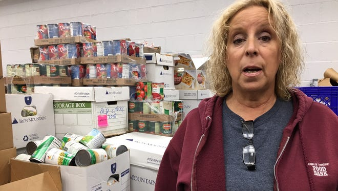 Nancy LaCorte, who handles donor development at the Franklin Food Bank, offers a tour of the facility.