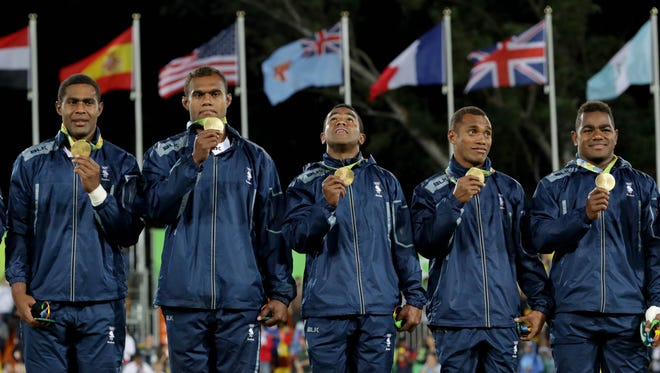 Team Fiji celebrates winning the gold medal after defeating Great Britain in the rugby sevens event at Deodoro Stadium in the Rio 2016 Summer Olympic Games Aug 11. in Rio de Janeiro, Brazil.
