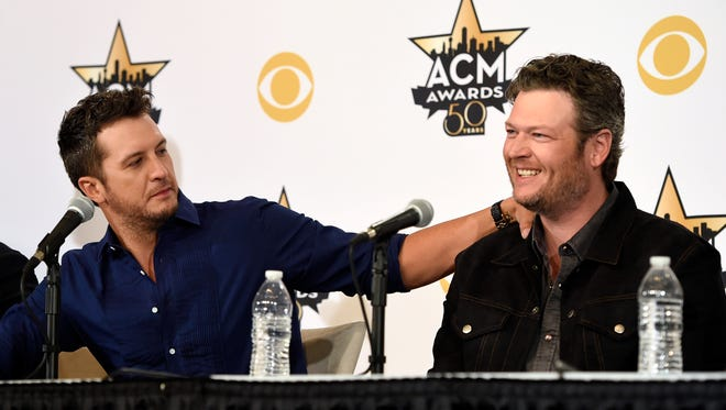 Luke Bryan, left, and Blake Shelton, co-hosts of Sunday's 50th Academy of Country Music Awards, take part in a news conference on the event at AT&T Stadium on Friday, April 17, 2015, in Arlington, Texas. (Photo by Chris Pizzello/Invision/AP)