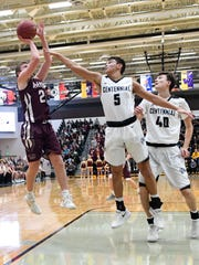 Ankeny's Will Cassel (2) goes up for a jump shots as
