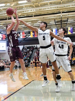 Ankeny's Will Cassel (2) goes up for a jump shots as Centennial's Hunter Strait (5) defends during a basketball game between the Ankeny Hawks and the Ankeny Centennial Jaguuars on Friday, Jan. 26, 2018 At Ankeny Centennial High School.