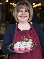 Kelly Speidel holds a tray of handmade Belgian white