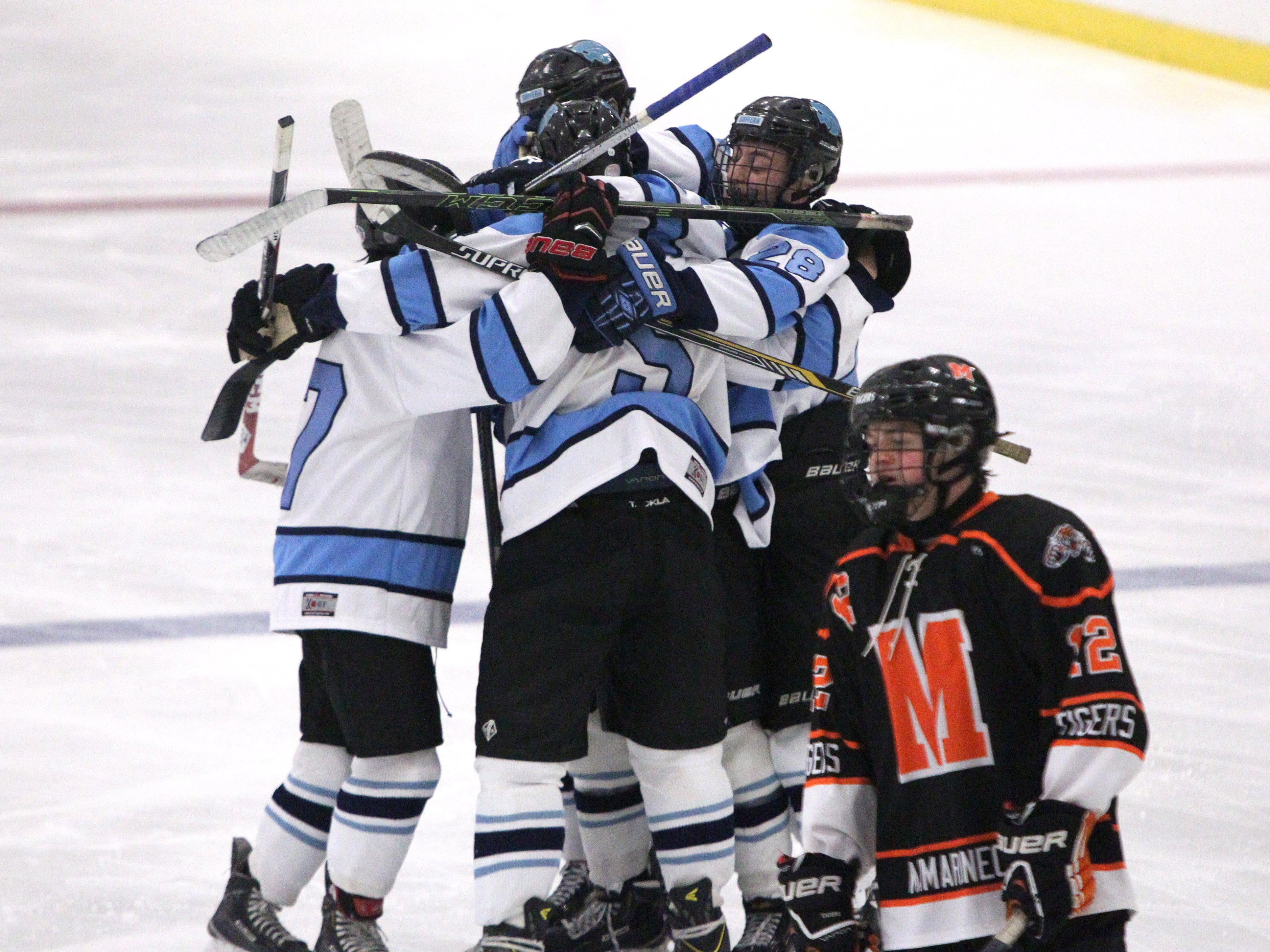 Suffern players celebrate Reed Stark's goal during their game with Mamaroneck at Sport-O-Rama on Friday night.