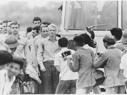 John McCain waiting for the rest of the group to leave the bus at the airport after being released as a POW in 1973.