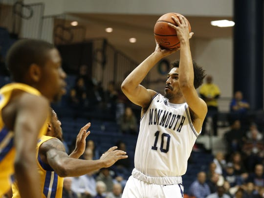 Monmouth Hawks guard Micah Seaborn (10) shoots over Hofstra Pride defenders during first half at Ocean First Bank Center.   Wednesday, December 6, 2017.  West Long Branch,NJ.  Noah K. Murray-Correspondent Asbury Park Press