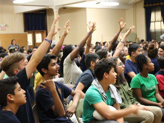 Belleville Middle School students raise their hands to answer a question during a presentation on bullying by Jets linebacker Lorenzo Mauldin on Friday, May 19, 2017.
