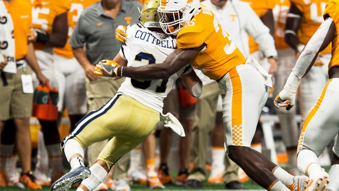 Tennessee linebacker Daniel Bituli (35) tackles Georgia Tech running back Nathan Cottrell (31) during the Chick-fil-A Kickoff Game at the Mercedes-Benz Stadium in Atlanta on Monday, Sept. 4, 2017.