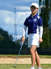 FRA's Angelina Chan reacts after narrowly missing a putt on the 17th green.