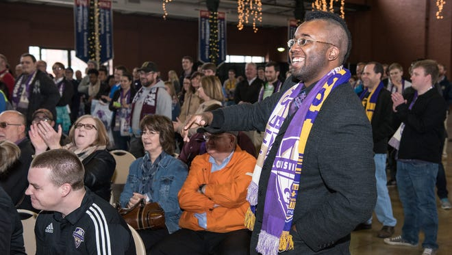 Augustus Waiters, a member of Louisville pro soccer support group The Coopers, asks how badly the Louisville City FC professional soccer team expects to beat St. Louis during an unveiling of their new kit for fans gathered at Louisville Slugger Field in downtown Louisville where the team will play their home matches. Mar. 26, 2015