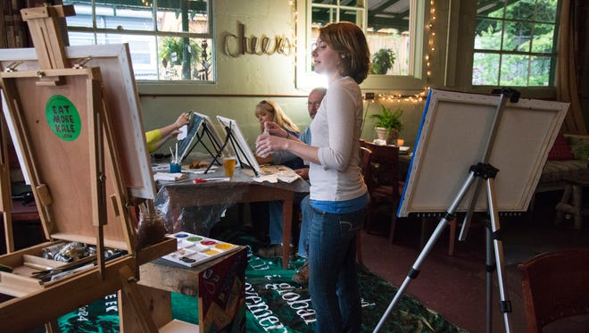 Lindsey Curtin leads Joyce Pemberton, Rusty Miller and Jenna Hernandez (not visible) on a recent night of painting at unWINE'd at Mellie Mac's.