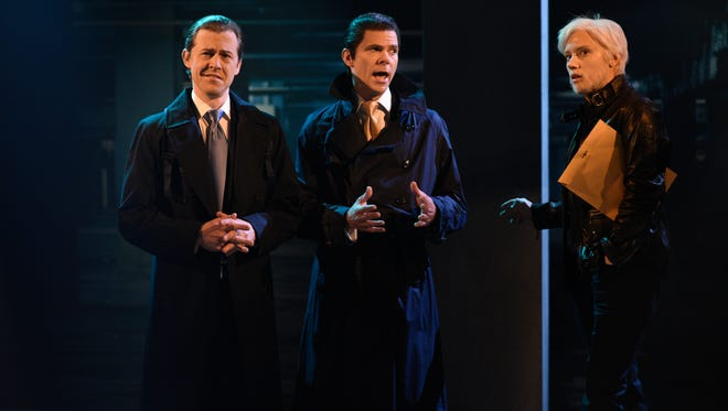 Eric Trump (Alex Moffat), left, Donald Trump Jr. (Mikey Day) and Julian Assange (Kate McKinnon) hold a clandestine meeting during the cold open of 'Saturday Night Live.'