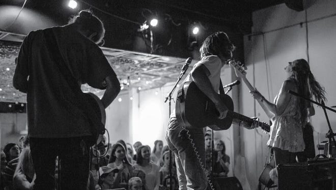 Tow'rs, a folk band from Arizona, plays a pop-up concert Monday night in The Metropolitan, formerly known as Chase Tower.