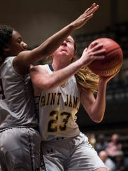 Saint James' Micala Fisanick (23) is fould as she goes