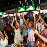 Soccer fans react during a viewing party at the River Rock Restaurant & Marina Bar in Brick.