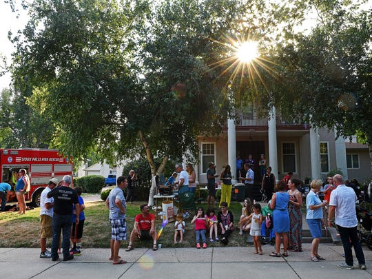 Neighbors gather for a National Night Out event Tuesday,