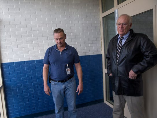 Principal Shannon Waller, left, and Ted Lasiewicz, the director of operations for the Farmington Municipal School District, talk about needed repairs on Friday at Country Club Elementary School in Farmington.