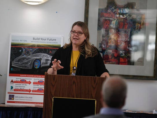 Melissa Meechan, director of San Juan College's Four Corners POWER Initiative, speaks on Monday during the Four Corners Future Forum Report event at San Juan College Quality Center for Business in Farmington.