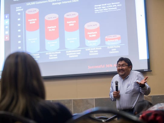 Leonard Gorman of the Office of the Navajo Nation Human Rights Commission speaks on Wednesdy during a seminar on small loans at the Farmington Civic Center.